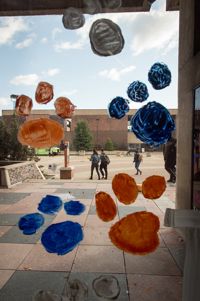 View through Student Union window painted for Homecoming at SUNY Buffalo State College.