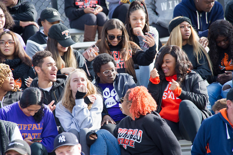 Students celebrating in stands at Homecoming football game vs. Union College at SUNY Buffalo State College.