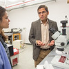Physics professor, Dr. Arjun Pathak and students working in research lab at SUNY Buffalo State College.