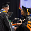 President Katherine Conway-Turner presenting diplomas at the Graduate Commencement at SUNY Buffalo State.