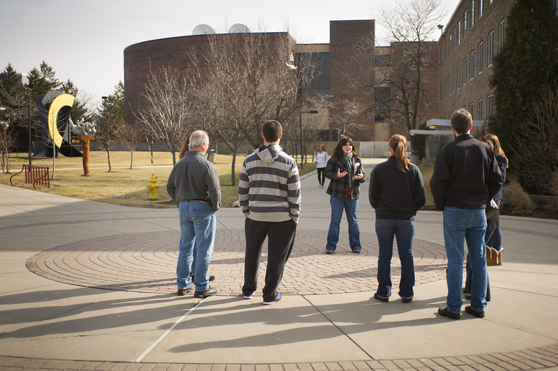 Student leading campus tour for prospective students and their parents.