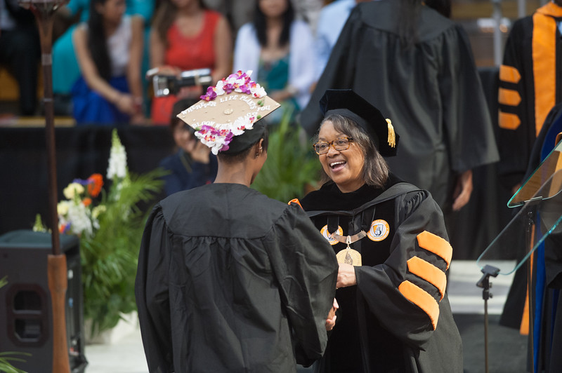 President Katherine Conway-Turner presenting diplomas at the 2pm Undergraduate Commencement at SUNY Buffalo State.
