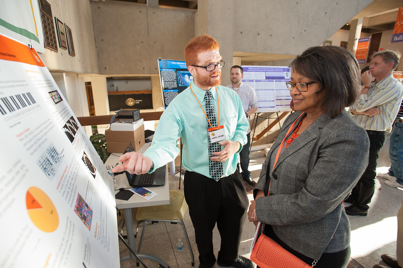 President Katherine Conway-Turner talking with student at the Student Research and Creativity Celebration at SUNY Buffalo State.