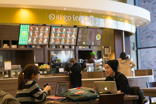 Students studying in Argo Tea area in Butler Library.