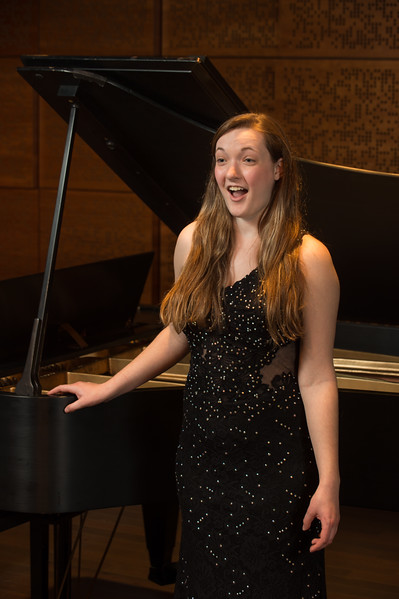 Buffalo State student Casey Wojcik singing in the Ciminelli Recital Hall.