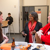 President Katherine Conway-Turner talking with students at the Graduate Thesis Awards reception at SUNY Buffalo State.