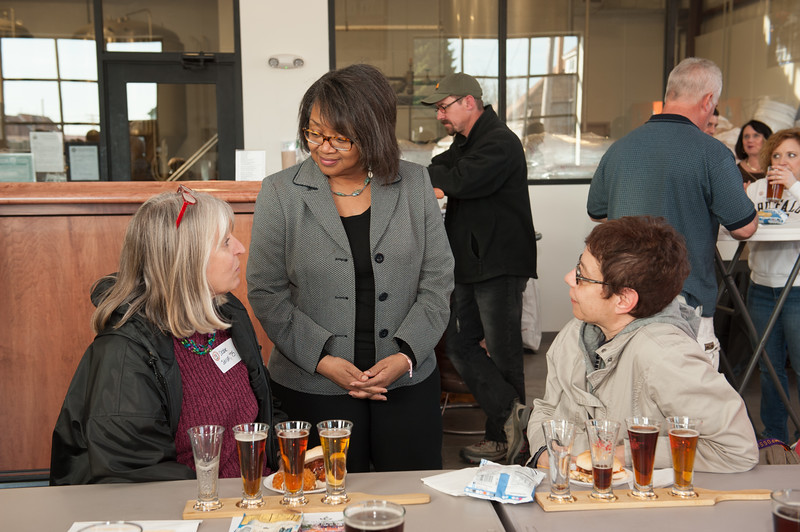 President Katherine Conway-Turner speaking to alumni at SUNY Buffalo State Alumni Association event at Flying Bison Brewery.