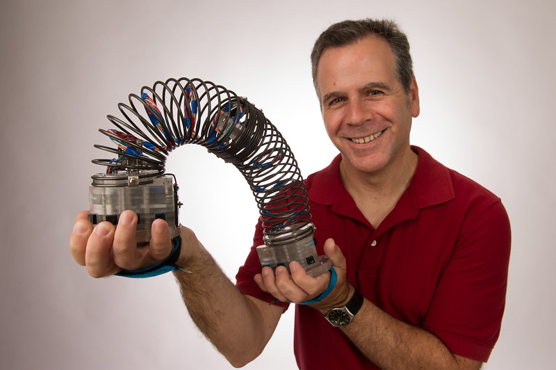 Music professor Tomas Henriques with the electronic musical instrument he created at SUNY Buffalo State.