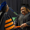 President Katherine Conway-Turner presenting diplomas at the 10am Undergraduate Commencement at SUNY Buffalo State.