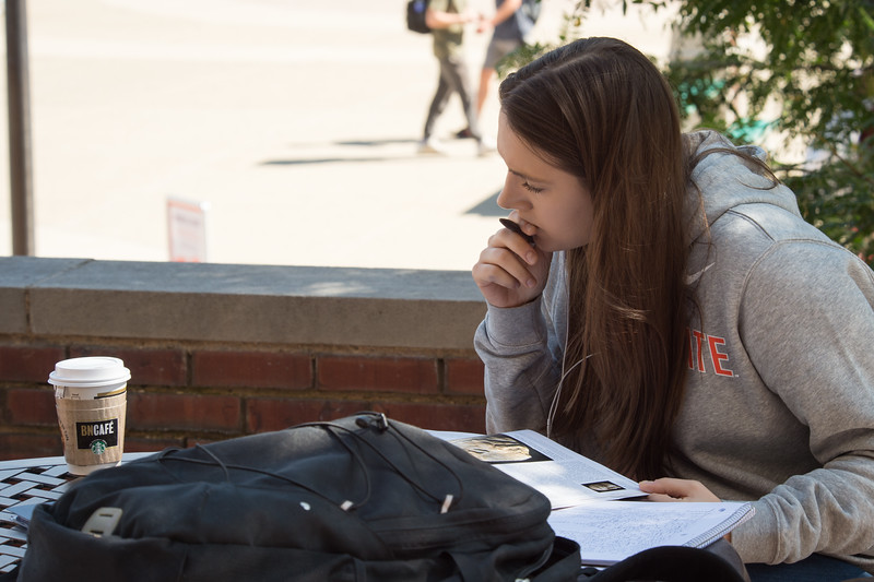 Student studying in Plaza at SUNY Buffalo State College.