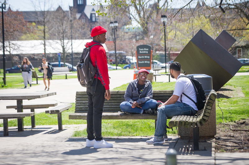 Campus scenic with students outside Twin Rise at Buffalo State College.