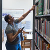 Student working in E. H. Butler Library at Buffalo State College.
