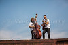 Jay Leonard and Sam Shoichet jamming on top of a box car at the Eli Bennett and Rosemary Siemens wedding weekend during Plumfest,  August 19-21, 2017 in Plum Coulee, Manitoba, Canada.