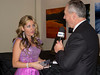 Al Friesen interviewing Rosemary Siemens at a reception sponsored by Golden West Broadcasting after Rosemary Siemens' world premier perfomance of the Mennonite Violin Concerto at the Centennial Concert Hall on December 2, 2012.