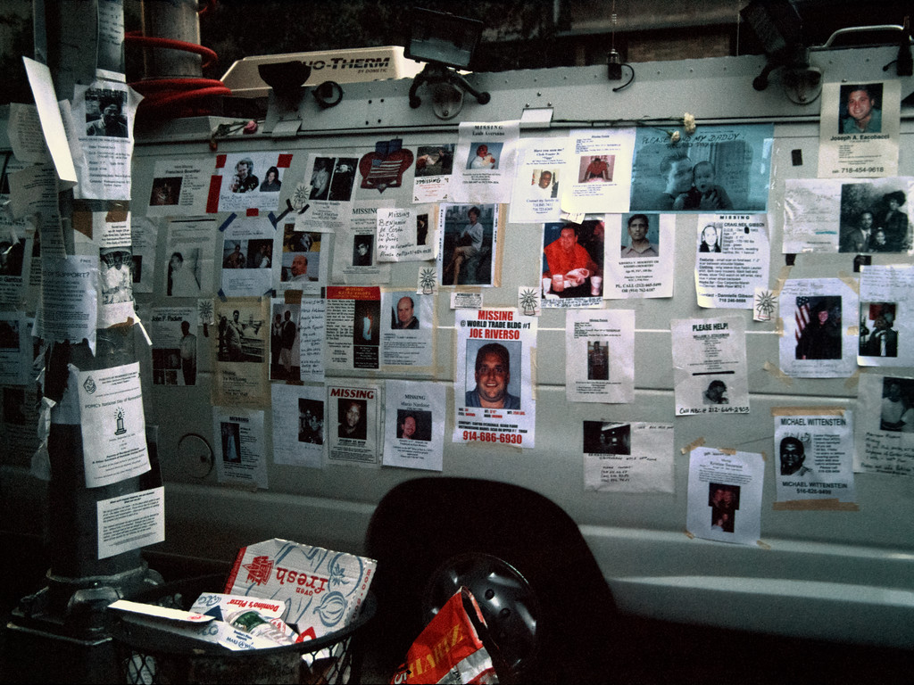Thousands of missing persons posters appear throughout New York City in the days following 9/11 - like these taped to a news van