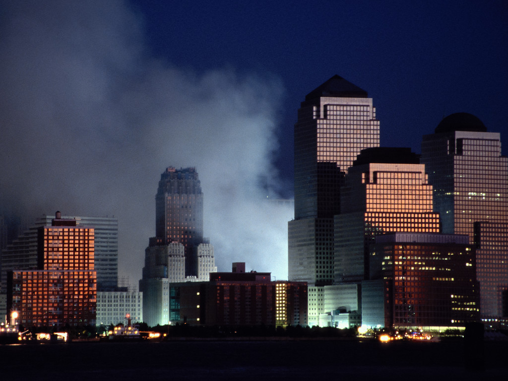 Lights illuminate smoke billowing from Ground Zero on September 12, 2001