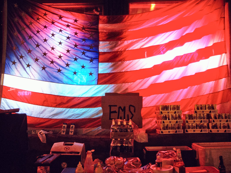 Supplies for EMS workers backlit by an American flag near Ground Zero