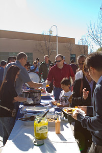 WE 01-20-13 irvine campus by Angelina Tse - Serving chili hot dog to irvine member for irvine small group event