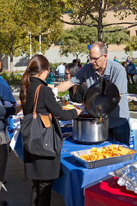 WE 01-20-13 irvine campus by Angelina Tse - Serving chili hot dog to irvine member