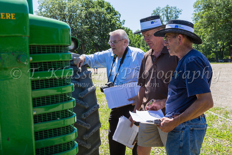 Judges at at the Eden Foundation 2013 Tractor Trek through the prairie landscape of southern Manitoba south of Winkler.