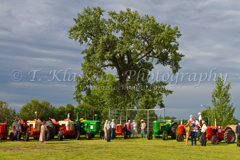A display of restored vintage farm tractors at the Tractor Trek event in Reinland, Manitoba, Canada.