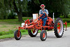 Mr. Abe Ens driving a restored vintage farm tractor at the Tractor Trek event in Reinland, Manitoba, Canada.