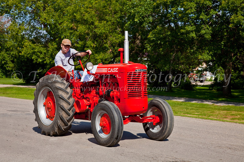 A procession of antique tractors at the 2010 Tractor Trek in Reinland, Manitoba, Canada.