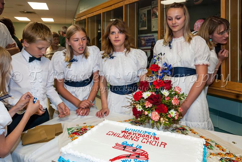 Cutting the anniversary cake at the 50th anniversary concert of the Winnipeg Mennonite Children's Choir in Winnipeg, Manitoba, Canada.