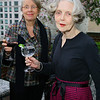 Joan Kedziora and Marjorie Ihrig enjoy pre-dinner cocktails on the Library terrace.