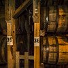 Inside a Maker's Mark rickhouse.  These barrels initially weigh between 400-500 pounds depending on age.  The barrels absorb gallons of whisky and some leakage and evaporation occurs over a period of years. For example, 20 year old aged products may lose two thirds of their original volume depending on the temperature and other conditions during the aging process.