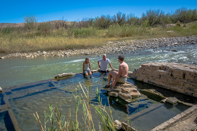 The hots springs are within the walls and are about hot tub temperature.  Some folks swing over to the Rio Grande to cool off.