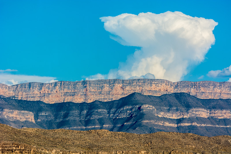 It is often difficult to convey the size of mountains, but this cloud head rising up from the other side of the Chisos Mountains helps.  Still, it is difficult to appreciate that this mountain range is over 7,800 feet tall.