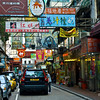 aeamador©-HK08_DSC0069      Hong Kong. Kowloon. Tsim Sha Tsui. Though not to be compared with what you find in Hong Kong island, it is quite a vibrant and lively city. People fill up the streets and sidewalks day and night for shopping, entertainment and more. Signs make a great show, especially at night, giving vibrancy and character to the city.