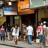 aeamador©-HK08_DSC0043      Hong Kong. Kowloon. Tsim Sha Tsui. Though not to be compared with what you find in Hong Kong island, it is quite a vibrant and lively city. People fill up the streets and sidewalks day and night for shopping, entertainment and more. Signs make a great show, especially at night, giving vibrancy and character to the city.<br /> Chic girls wear boots.