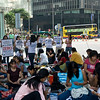 aeamador©-HK08_DSC0082  Hong Kong, downtown area, near ifc tower. I was very impressed by the affluence evidenced in this area. Hong Kong is quite a chic and fine place.<br /> These are Filipino maids that fill the entire downtown public spaces (sidewalks, streets and plazas) for picnicking. There are thousands of them, spread all over. No husbands, no men, no children. Just the women. Sunday is their day off.