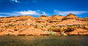 Blue sky, sandstone hills, and cool water