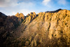 Higher up the huge boulders gave way to massive cliffs.
