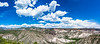 This panorama includes many tent rocks that look tiny compared to the broader landscape.