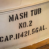 That's a lot of mash.  Some of the tubs are steel and some are wooden.