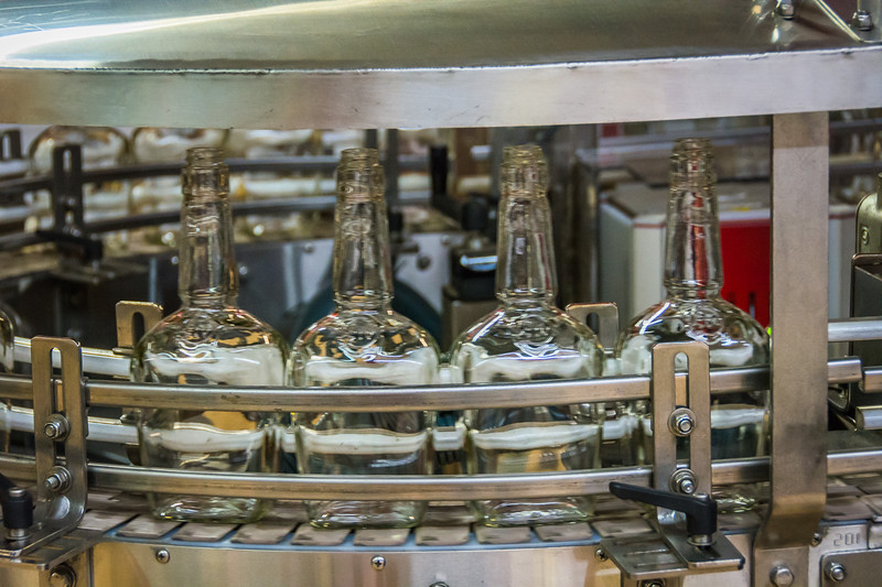 After the mash vats and rickhouse tour we went into the bottling area.  Here you see bottles whizzing by ready to be filled.