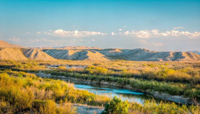 The Rio Grande River divides the US and Mexico. If you walk, swim, or boat to the other side you are in Mexico, and have usually entered illegally both going and coming.  The only legal crossing in Big Bend is the Boquillas Crossing Port of Entry.