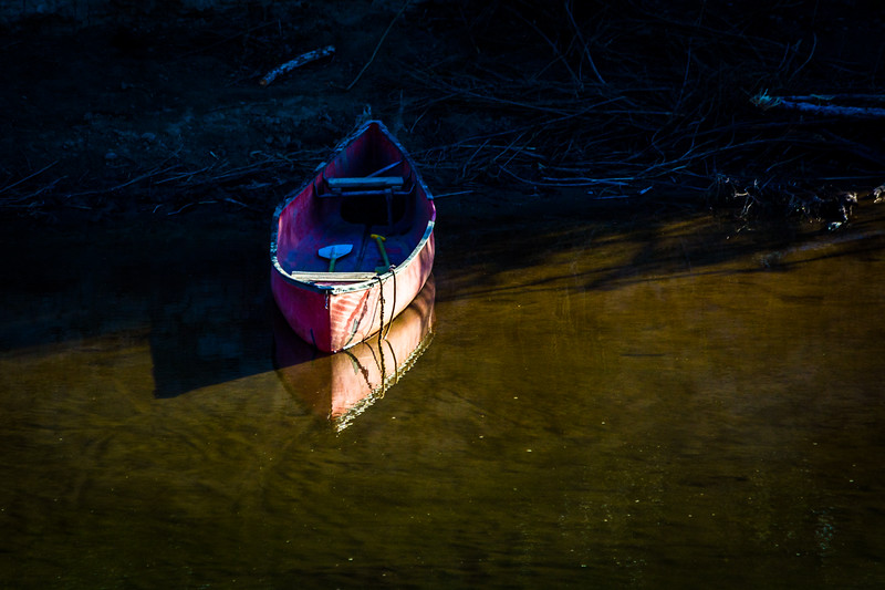 """This boat is on the Mexico side of the Rio Grande River.  Mexican nationals come across at random times to check for payments for their crafts and replenish stock if needed.  Sometimes they can be seen on the  Mexico side monitoring their """"souvenir stands.""""  When they see someone purchase an item they cross the river  to collect their """"donation."""""""