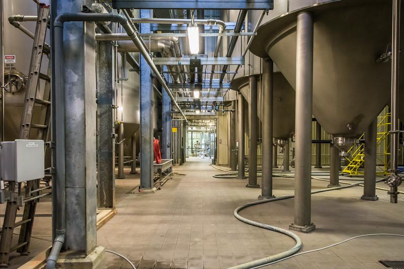 Each tank holds hundreds of barrels of beer.