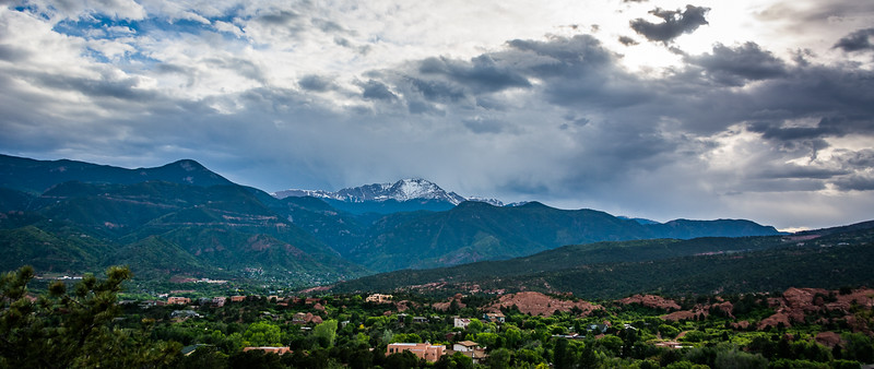 The Garden of the Gods is off to the right and Pikes Peak is the snow covered mountain ahead.
