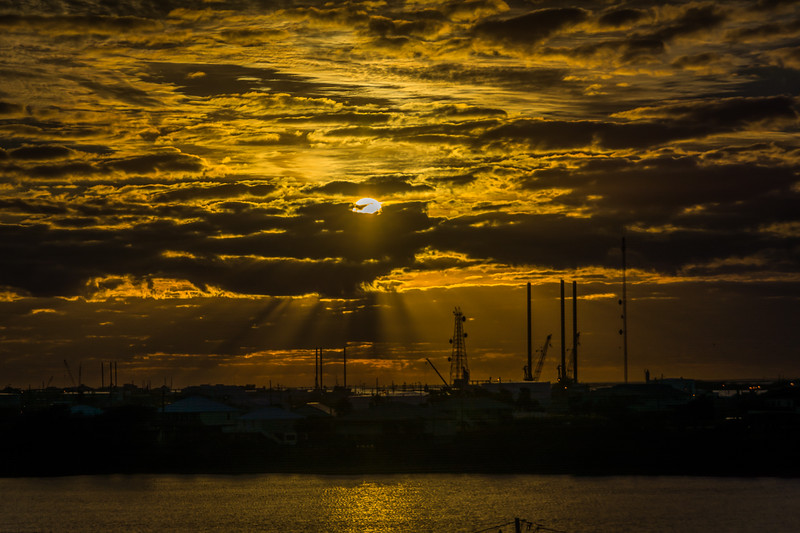 Sunset among the many cranes, towers, and derricks on Grand Isle.