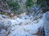 """As we started back you can see the jumble of massive rocks through which each hiker gets to pick a path.  Again, there is no defined or marked trail.  """"Just follow the wash"""" is the best advice."""