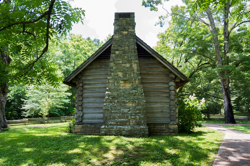 Log house replica of one of the church founders