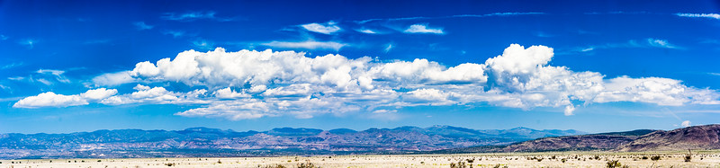 This panorama shows how the cloud formations are often as big and bold as the mountains.