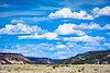 This is a landscape with seemingly endless canyons and clouds.