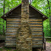 Traditional cabin chimney shows excellent craftmanship.